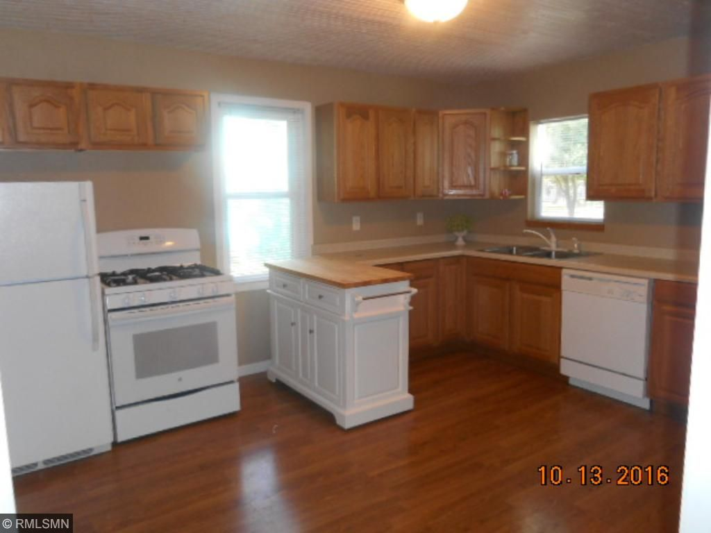 Big country kitchen with pretty wood floor