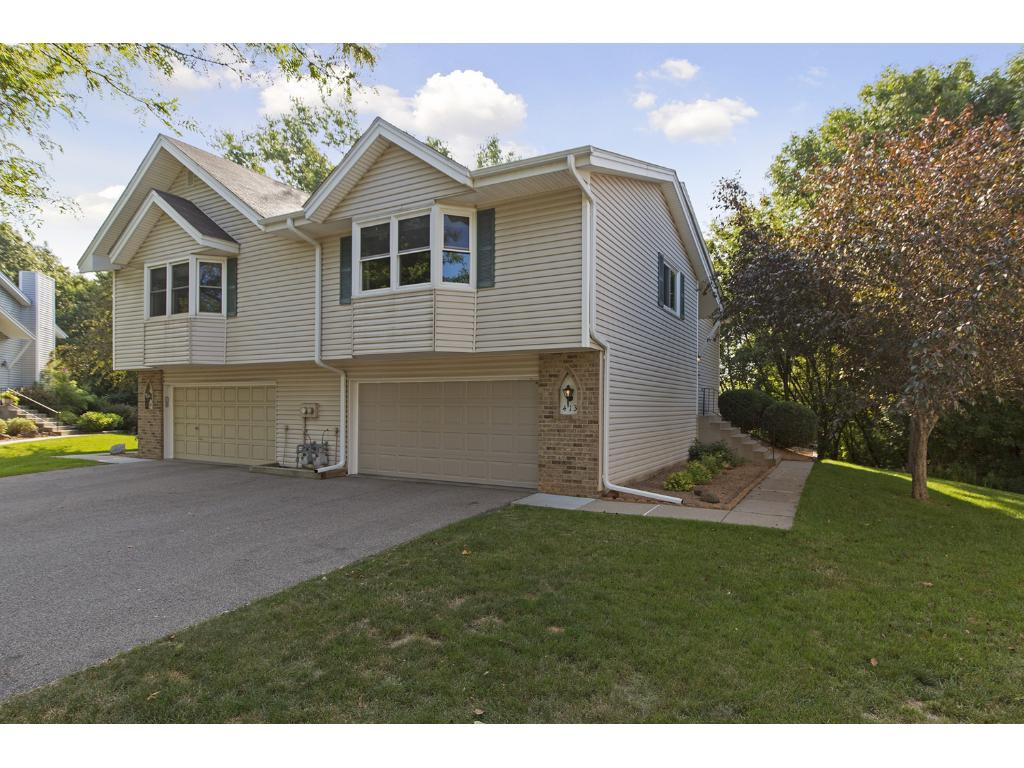 """Stunning, 2br/2ba, end unit townhome with quality updates throughout.  See highlight sheet located under supplements for a long list of updates that make this home a """"gem"""".  Beautiful .70 walkout lot with mature trees and a quiet cul-de-sac setting."""
