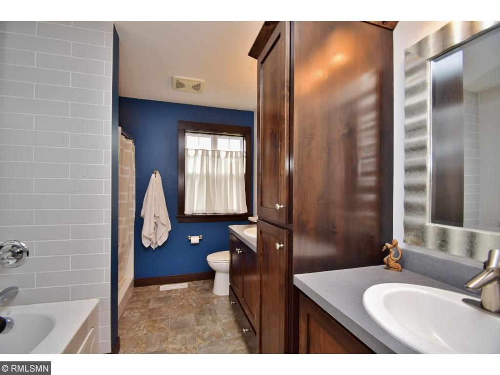 Private bath with double vanity sink and cabinets