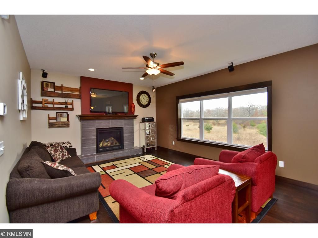 Gas fireplace and views of the backyard