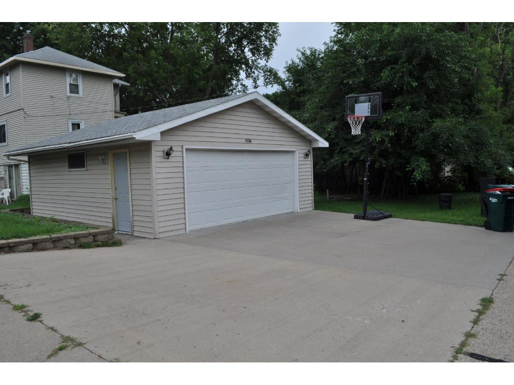 Newer good sized 2 car garage with ample room for parking and hoops!