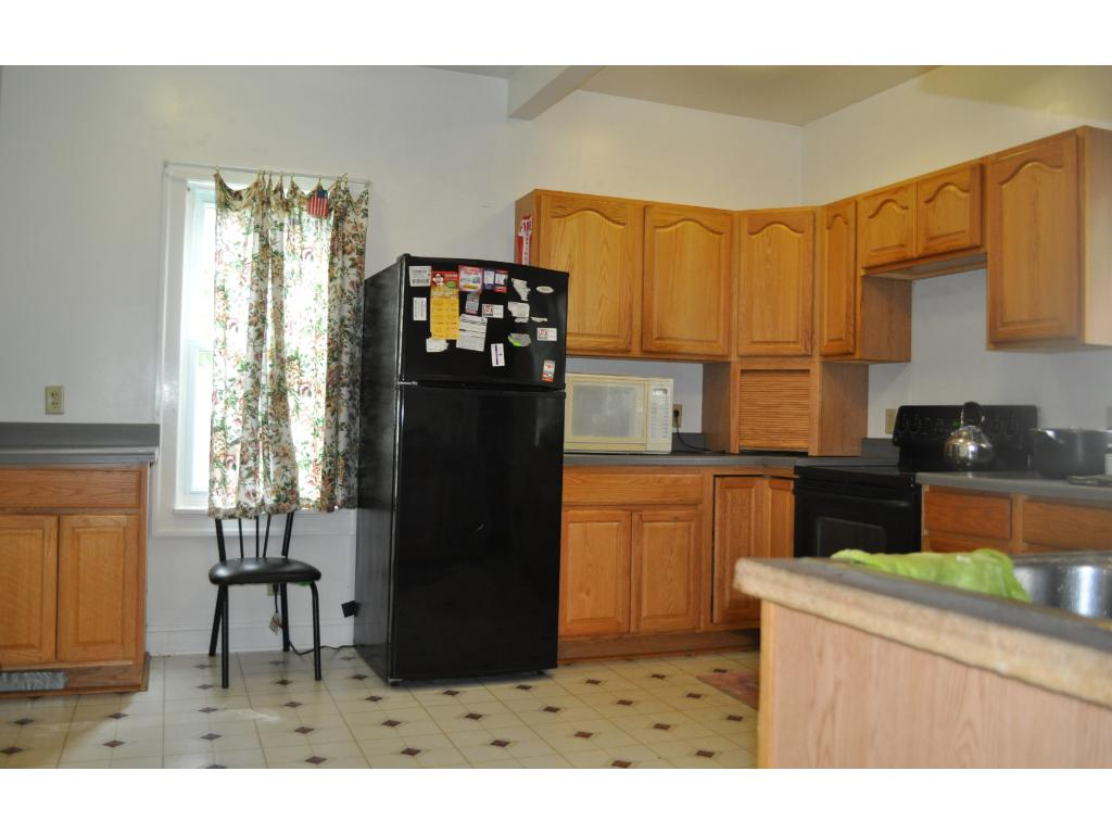 Large kitchen plus an alcove to the left of the refrigerator with more storage space