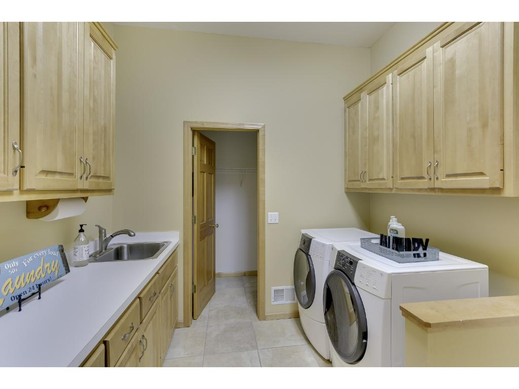 Main floor laundry with large mudroom and closet and extra storage.