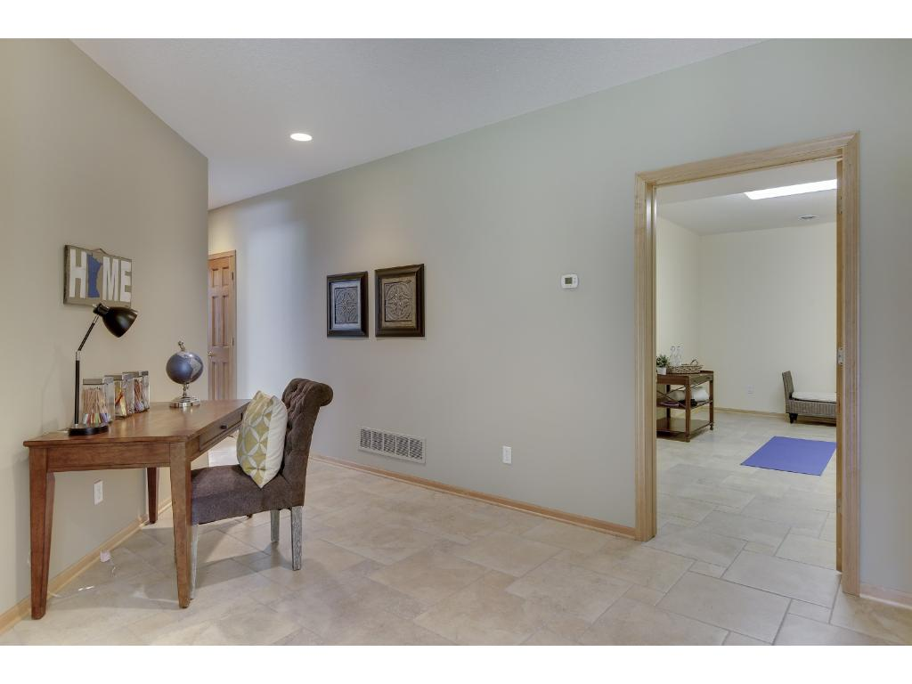 This home boasts over half and acre on a semi private lot