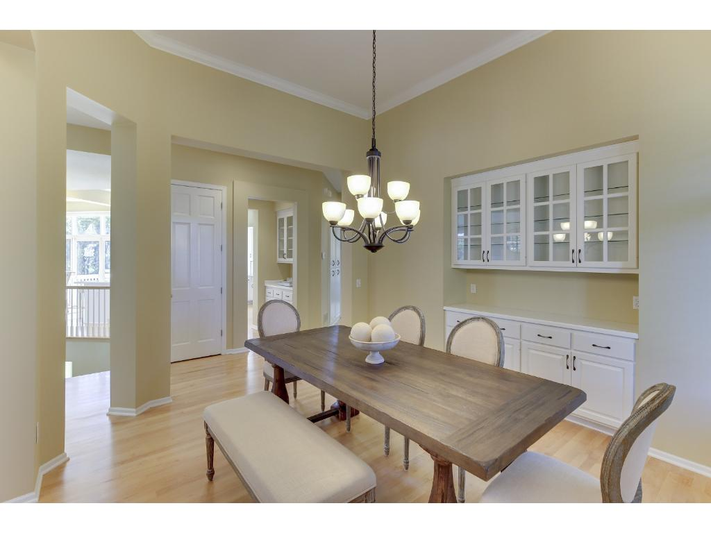 Formal dining with plantation shutters and built in buffet.  Butler's pantry to the kitchen makes entertaining for family and friends easy.