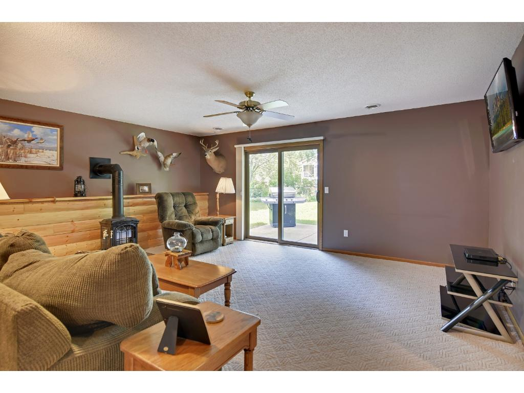 Spacious family room walking out to beautiful patio on landscaped grounds