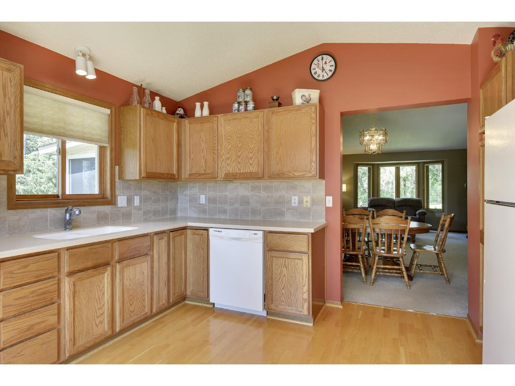 Spacious kitchen with lots of cabinets and counter space makes preparing meals easy
