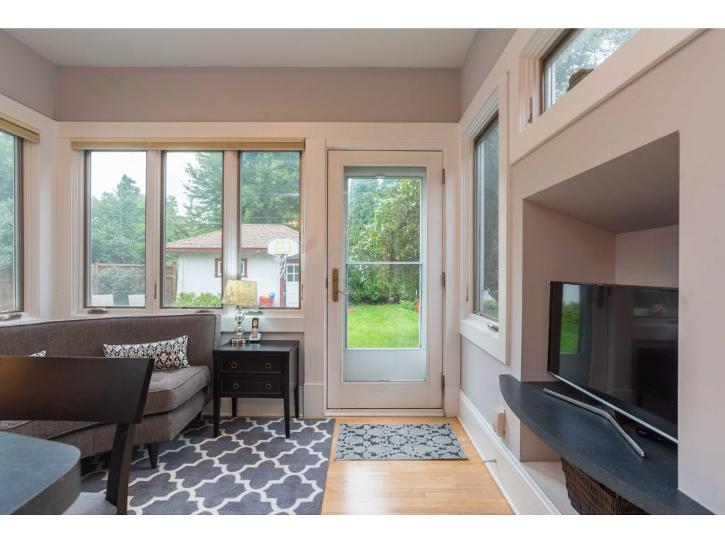 Back sunroom off kitchen perfect for family lounging walks out to patio