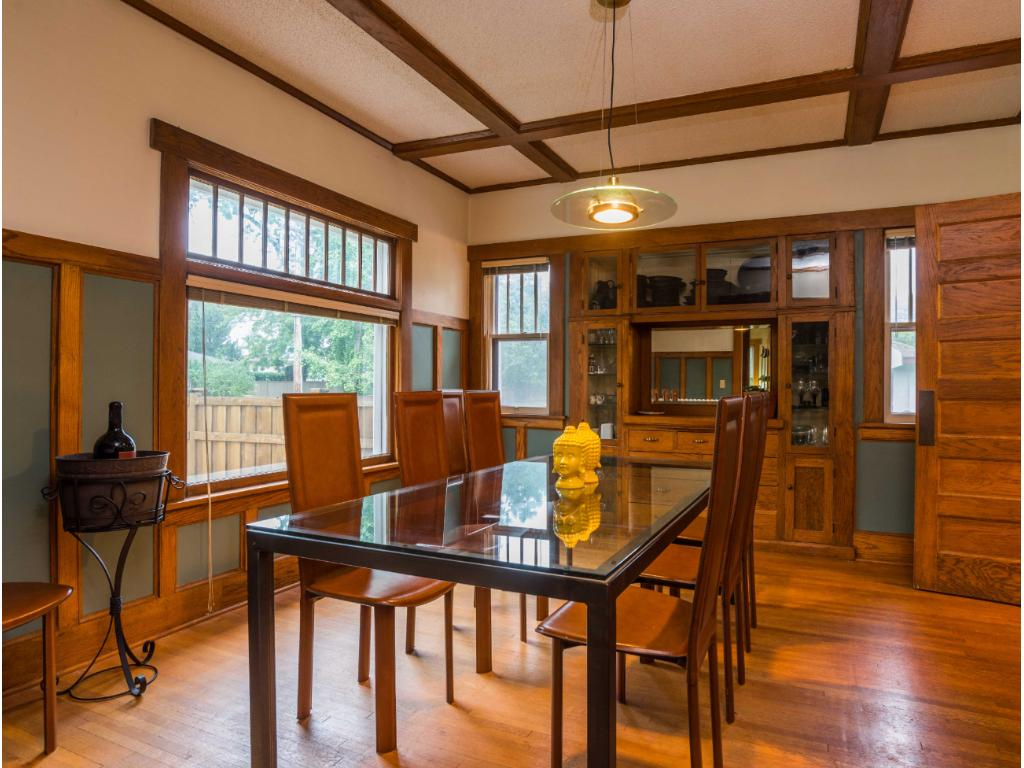 Beautiful woodwork, built-ins, box beam ceiling and leaded glass window