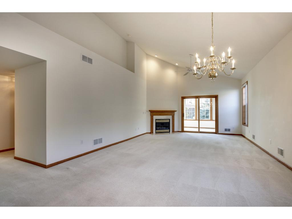Spacious living room with fireplace and vaulted ceilings.