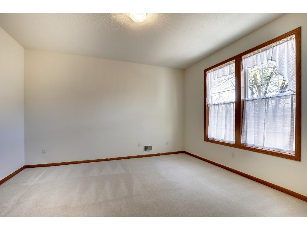 Master bedroom has big windows to let in plenty of natural light.