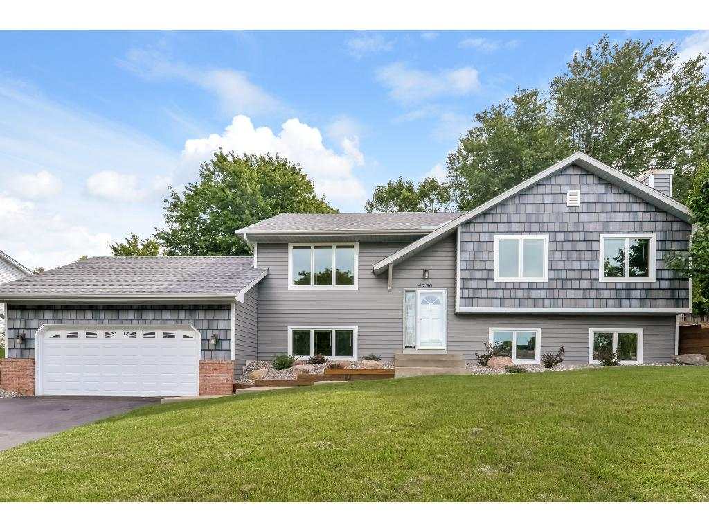 This home shines, new roof, siding, landscaping, Andersen windows and patio door, newer AC, new carpet in lower level family room, fresh paint and more!