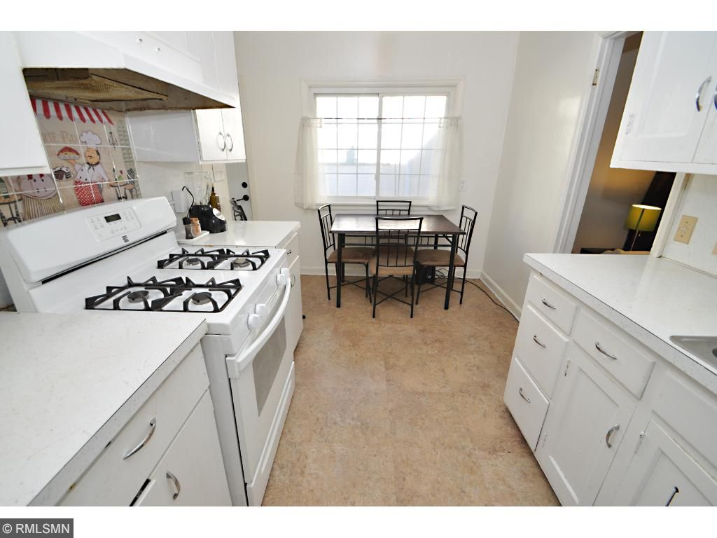 Clean galley style kitchens with gas cooking