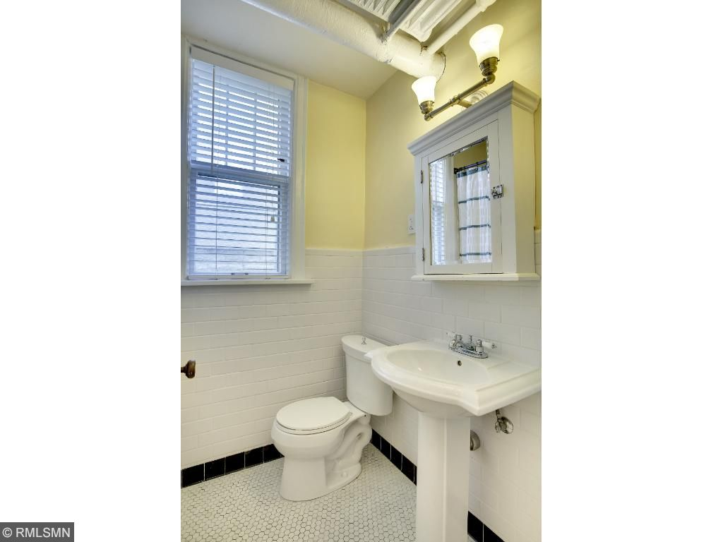 Full bathroom features a pedestal sink and subway tile!
