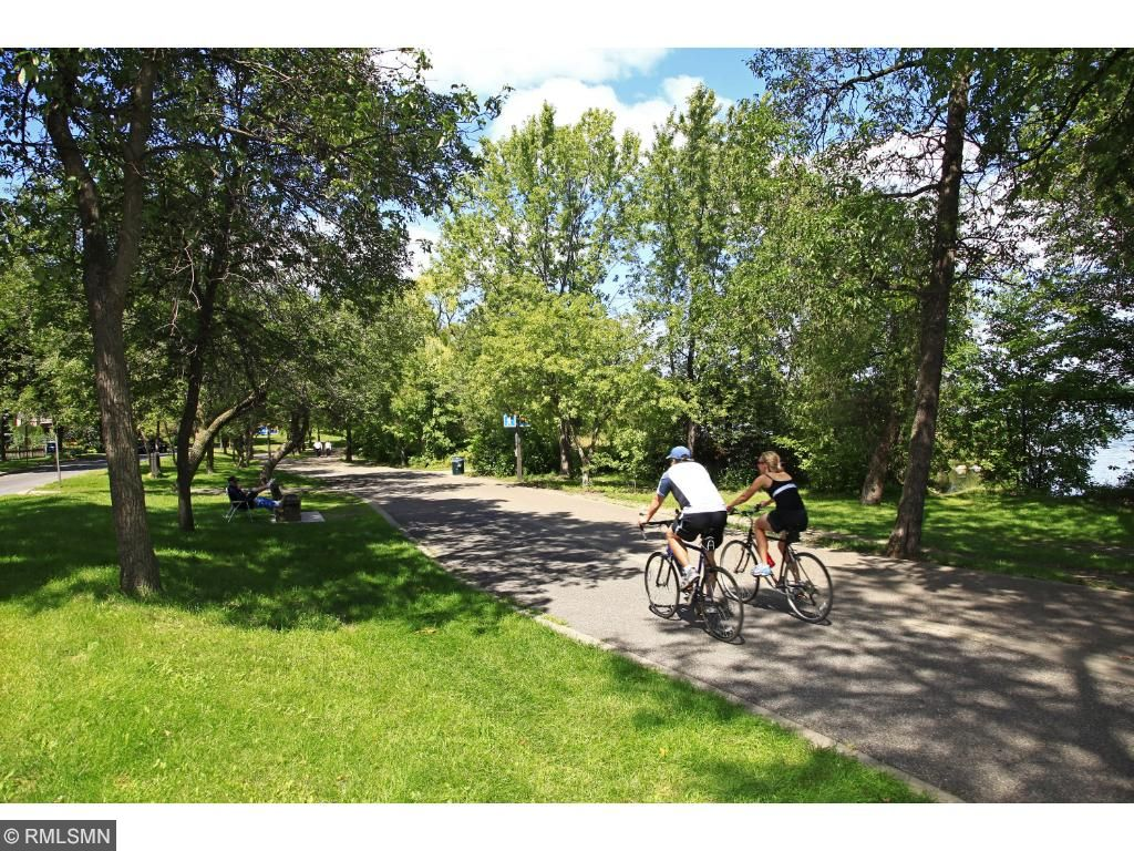 Surrounded by bike paths and walking trails throughout the Chain of Lakes