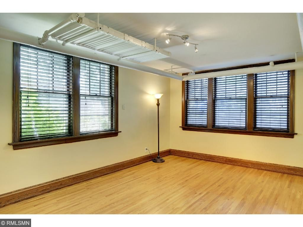 Living Room is spacious and features newer oak hardwood floors to match it's original style.