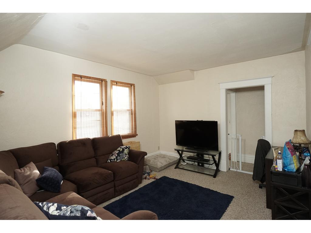 Upper level family room/playroom 11 x 14 with newer windows.