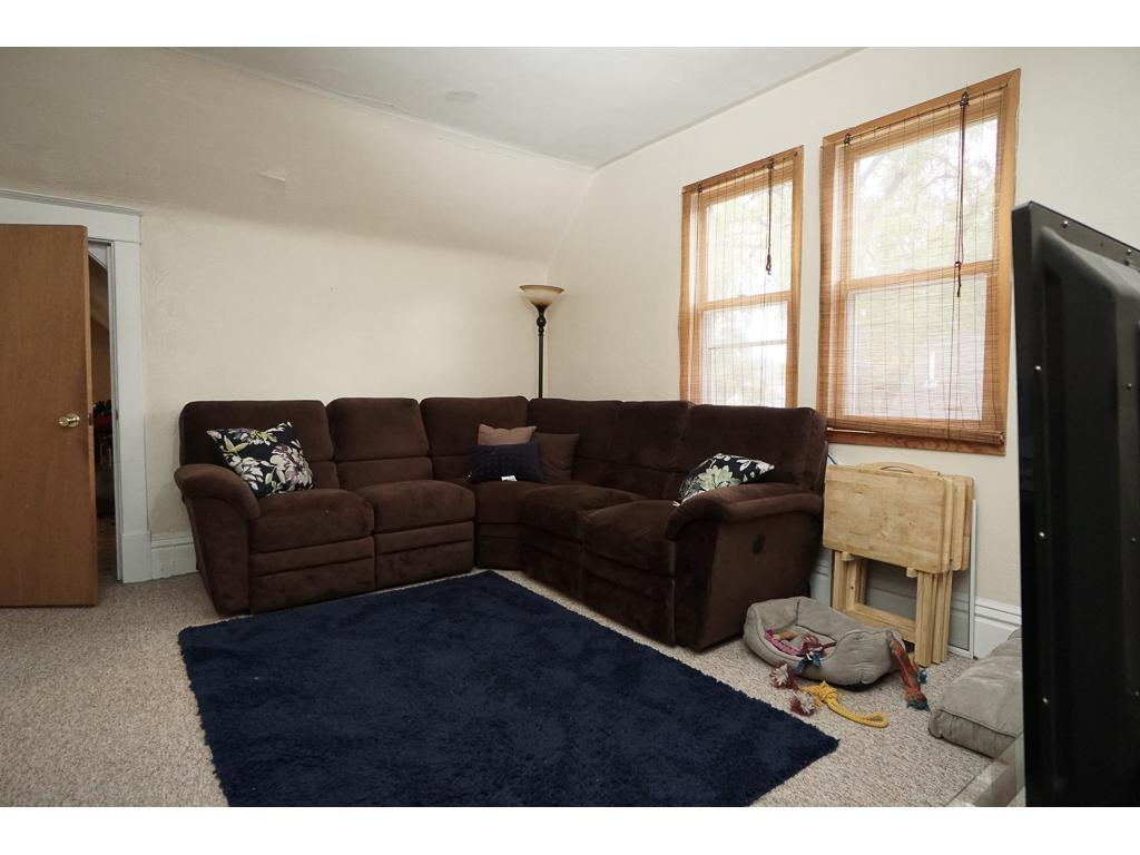 Upper family room or playroom 11 x 14 with newer windows.