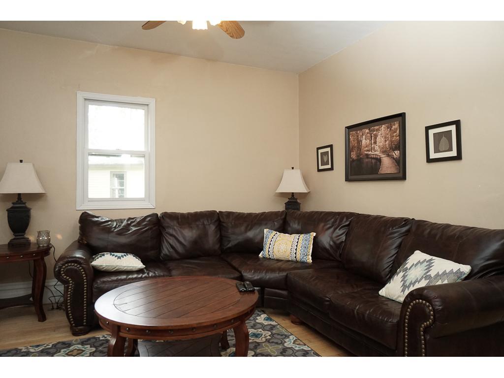 Spacious Living room with hardwood floors and plenty of light. 13 x 12