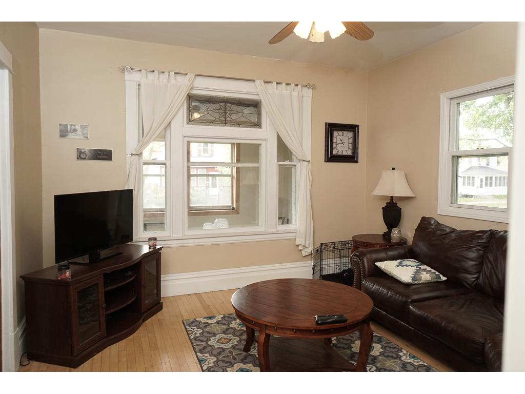 Living room with decorative transom and wide mill-work trim.