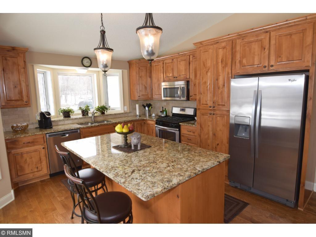 Granite Tops Hardwood Floors Custom Knotty Alder Cabinets And Stainless Steel Liances