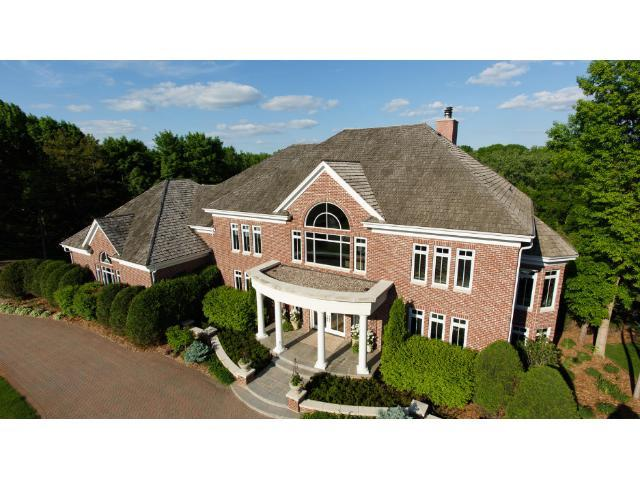 Welcome to this private estate with deeded dock and lake access on Lake Minnetonka.