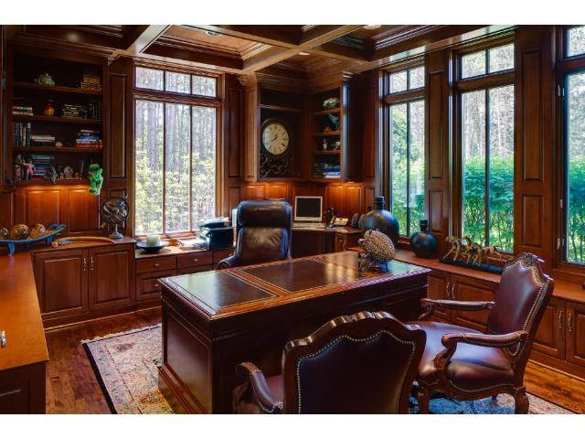 The study is enhanced with cherry wood paneling and cherry wood cathedral ceiling with both recessed and under cabinet lighting. Custom cherry cabinets complete this sophisticated space.