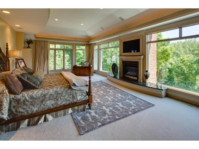 Spacious and tranquil Master Suite. Fireplace, Tray ceiling, specialty lighting, and wall to wall floor to ceiling windows for exceptional views and light.