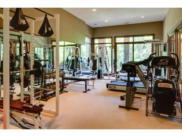 No need for a gym membership when you have a state of the art facility in your lower level including floor to ceiling windows and mirrors, a steam shower, full bath and sauna.