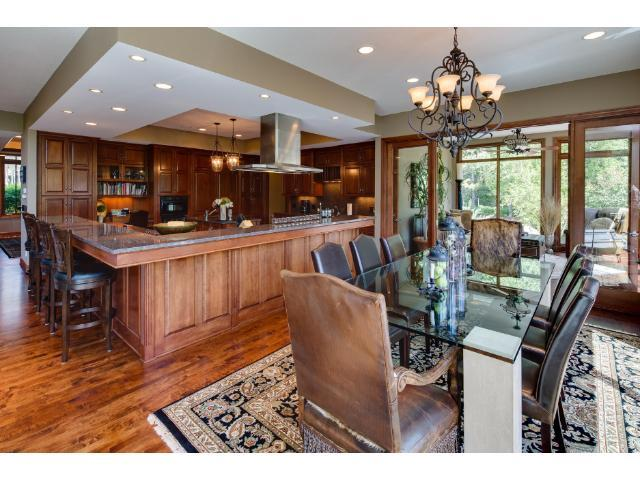Gourmet kitchen with custom cherry cabinetry, gleaming granite counter tops and top of the line appliances.