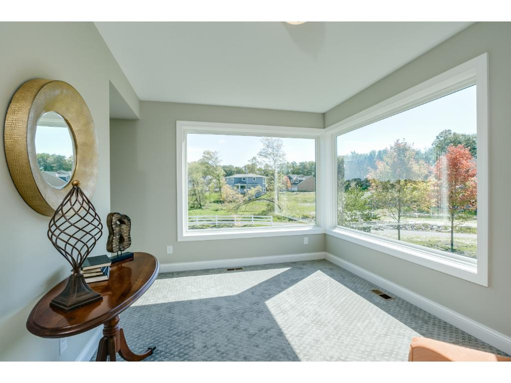 Sunroom on Main level to sit back and relax.  Bonus Space for the Kids..