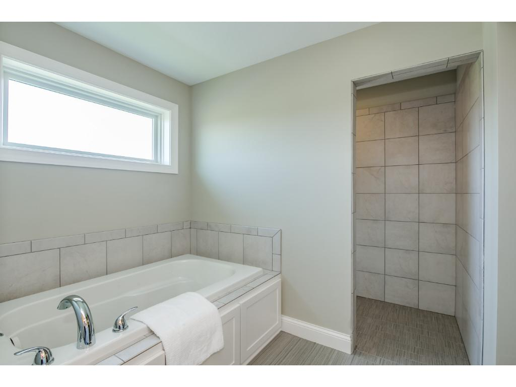 Custom Tub and shower at owners suite- With Enormous Walk in Closet
