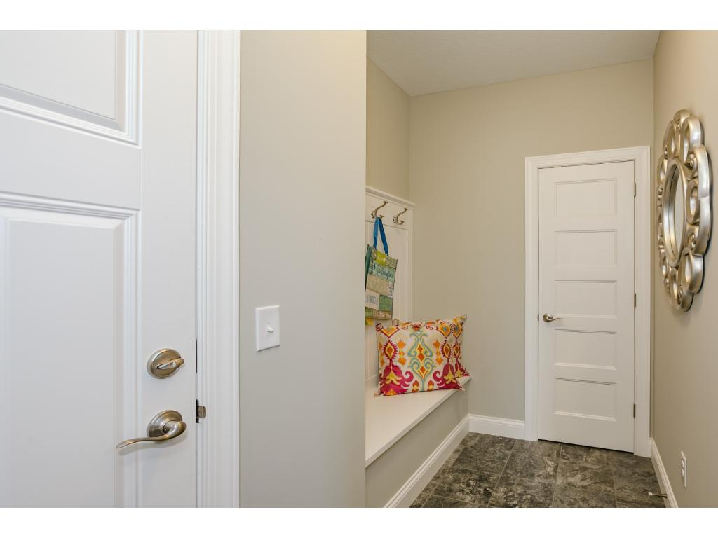 Spacious Mudroom with Walk in closet and Bench with Bead Board and Hook Strip..