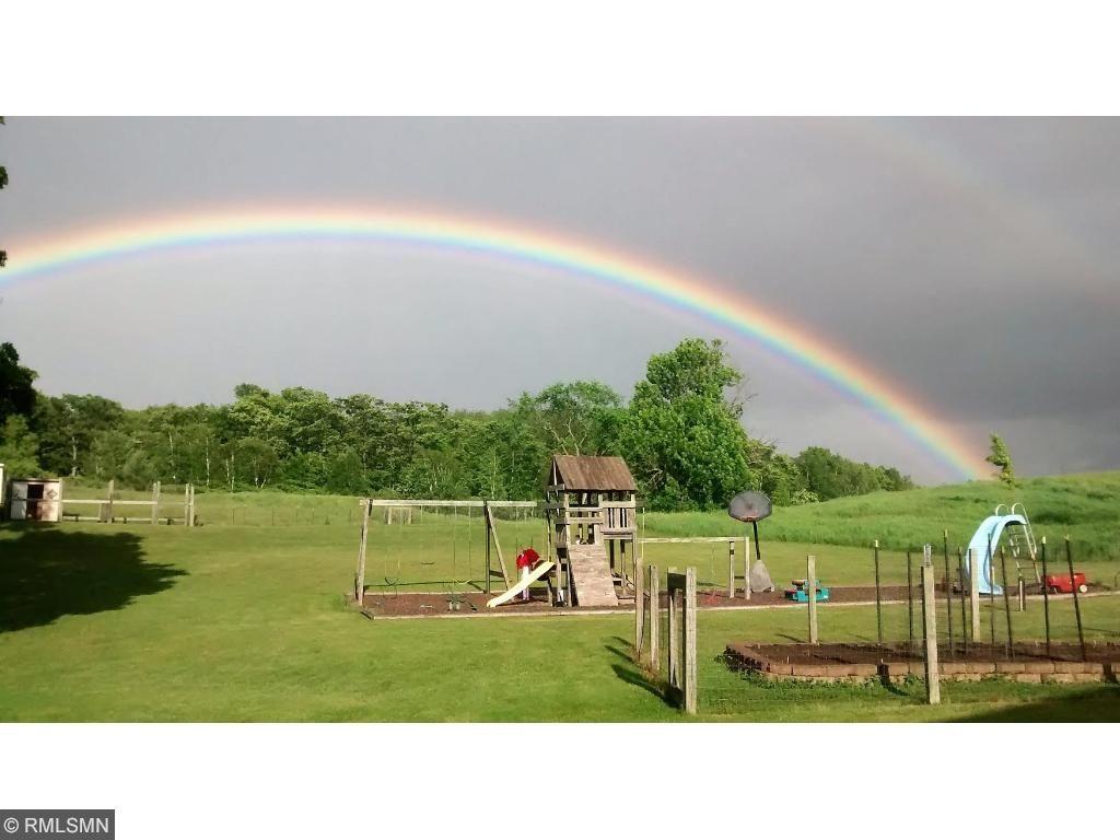 Gorgeous backyard, swing set area and fenced garden.