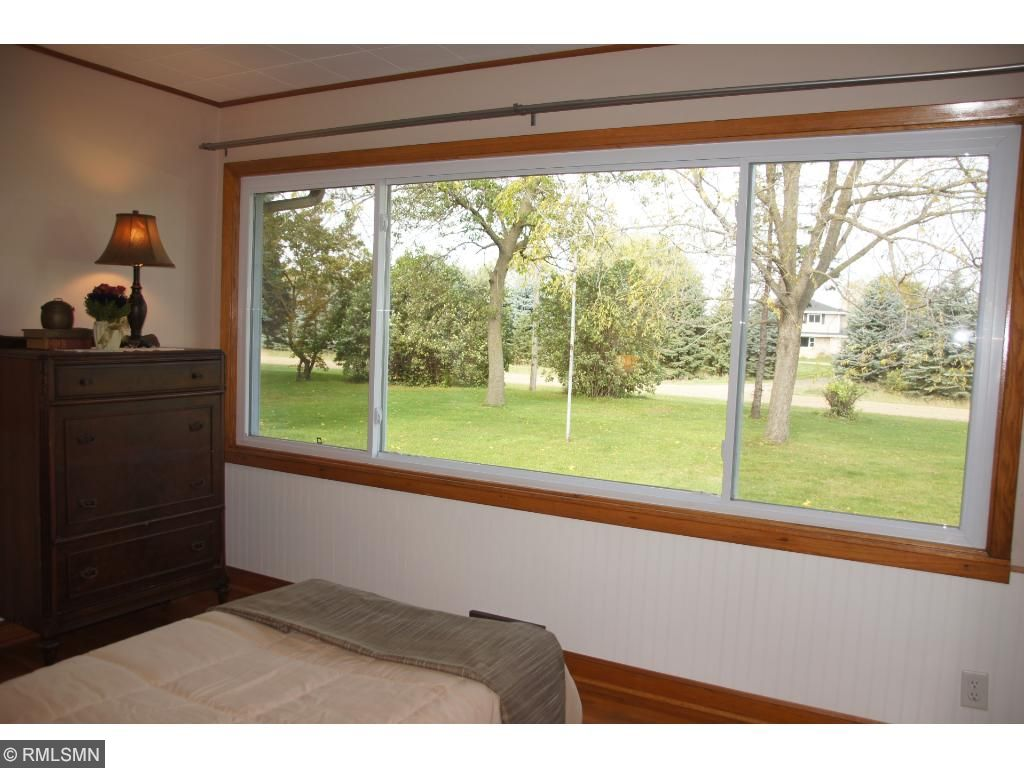This bedroom would be perfect sewing/craft room with these large windows