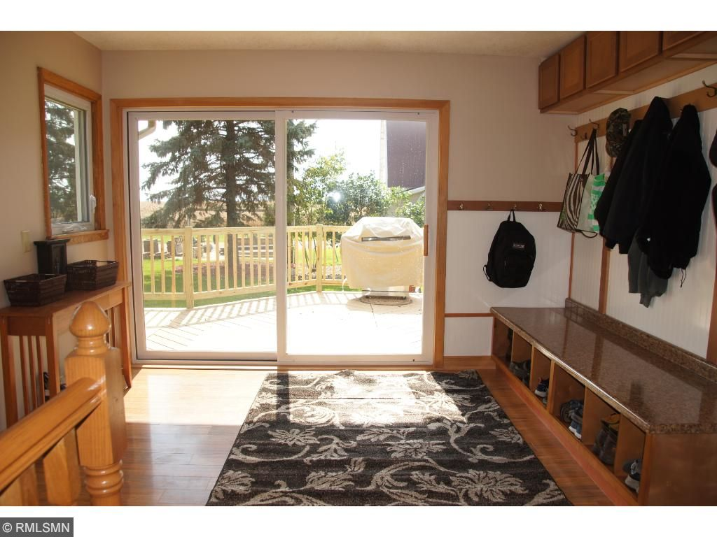 Large mudroom leads right to shower and laundry room