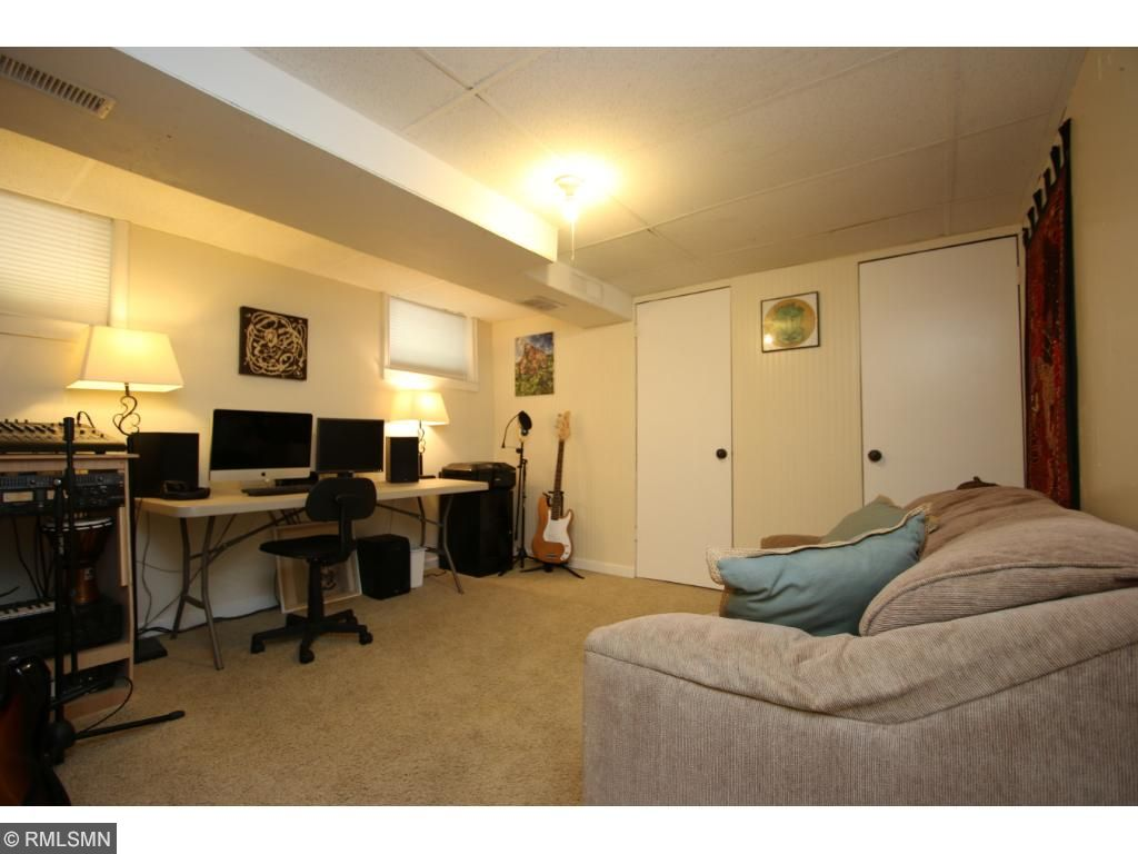 Lower level family room...or office...or playroom...or workout room!  Bring your ideas to this versatile space!