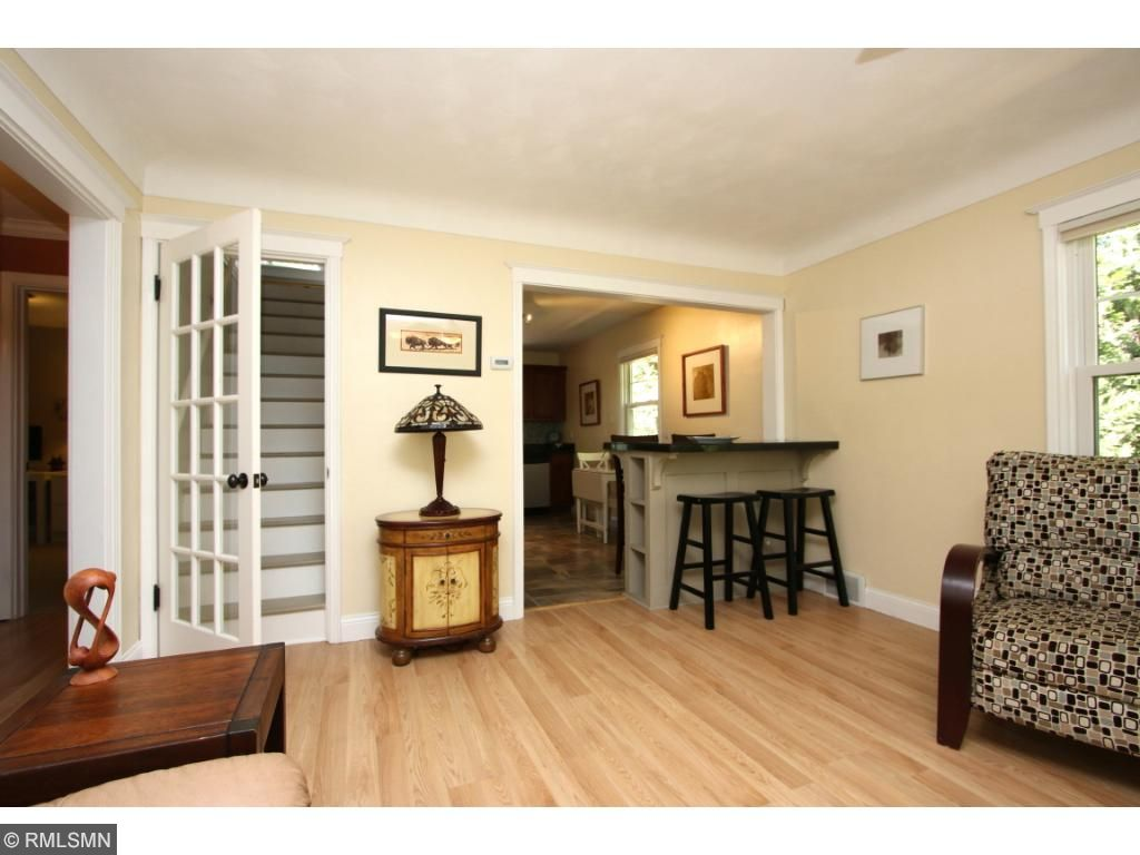 Charming paned glass door to upper level master, open main living spaces