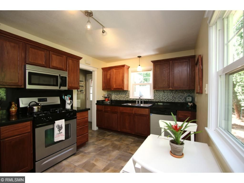 Plenty of space for a bistro table in the kitchen for casual dining.
