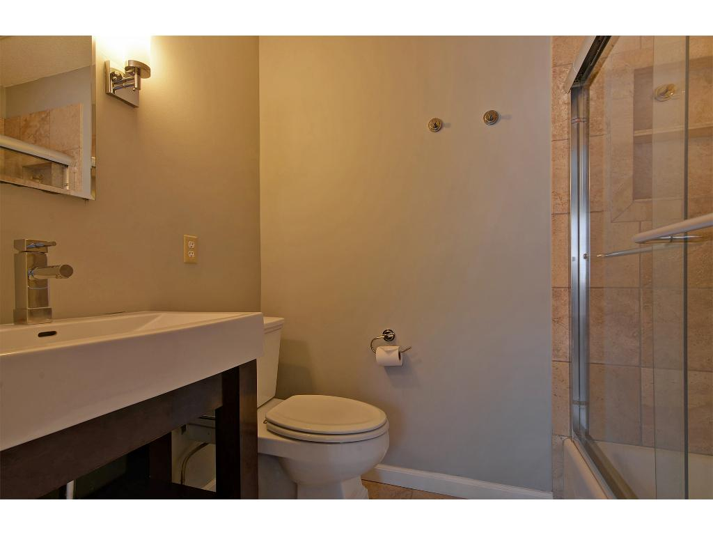 The master bath features a well-apportioned shower and updated vanity.