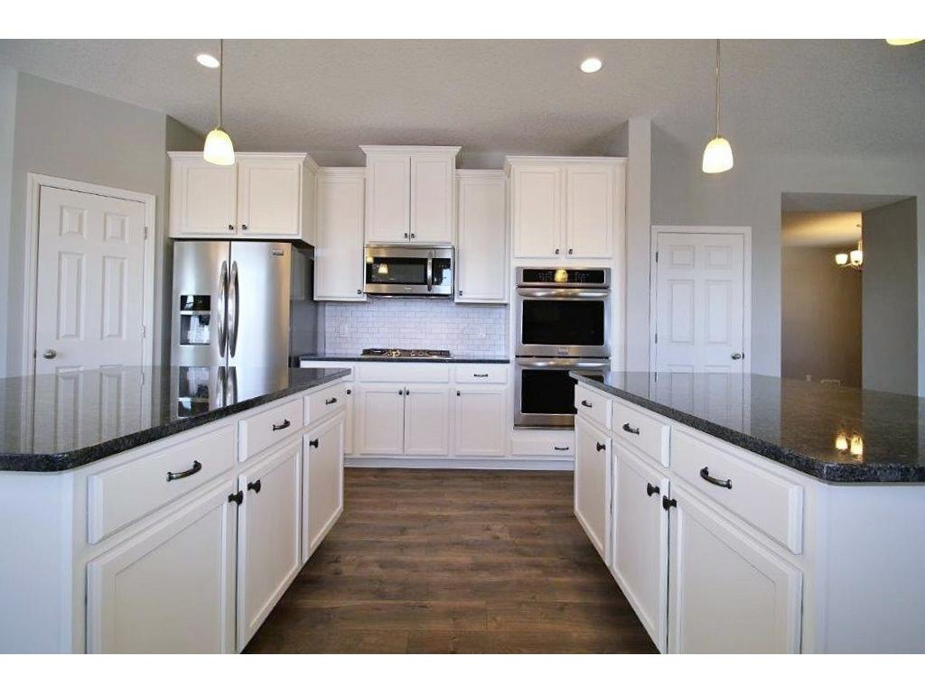 This is a to be built. Pictures with many similar finishes and they are of our previous showcase Madison model in Eden Prairie that sold quickly. Color and finishes may vary. Click next photos for additional kitchen pictures and more.