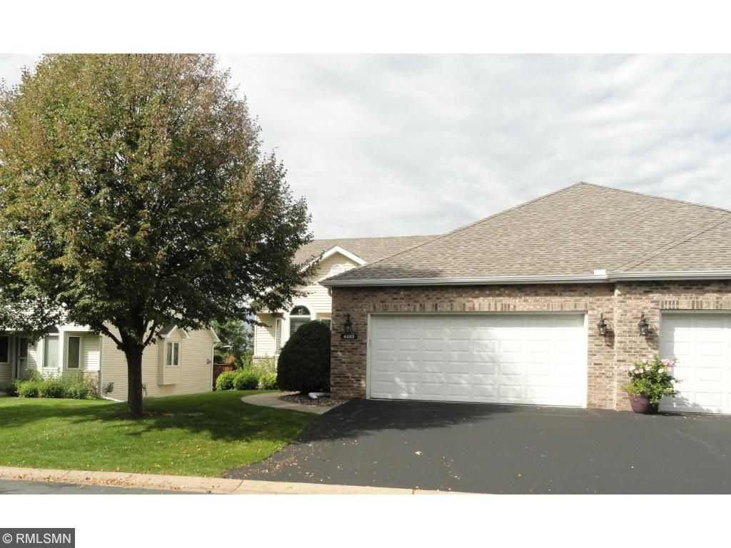 Terrific rambler style twin home, open and bright, vaulted main level, open kitchen with bay window dinette, oak hardwood and ceramic floors, granite, central vacuum, 6 panels doors,  the list goes on...