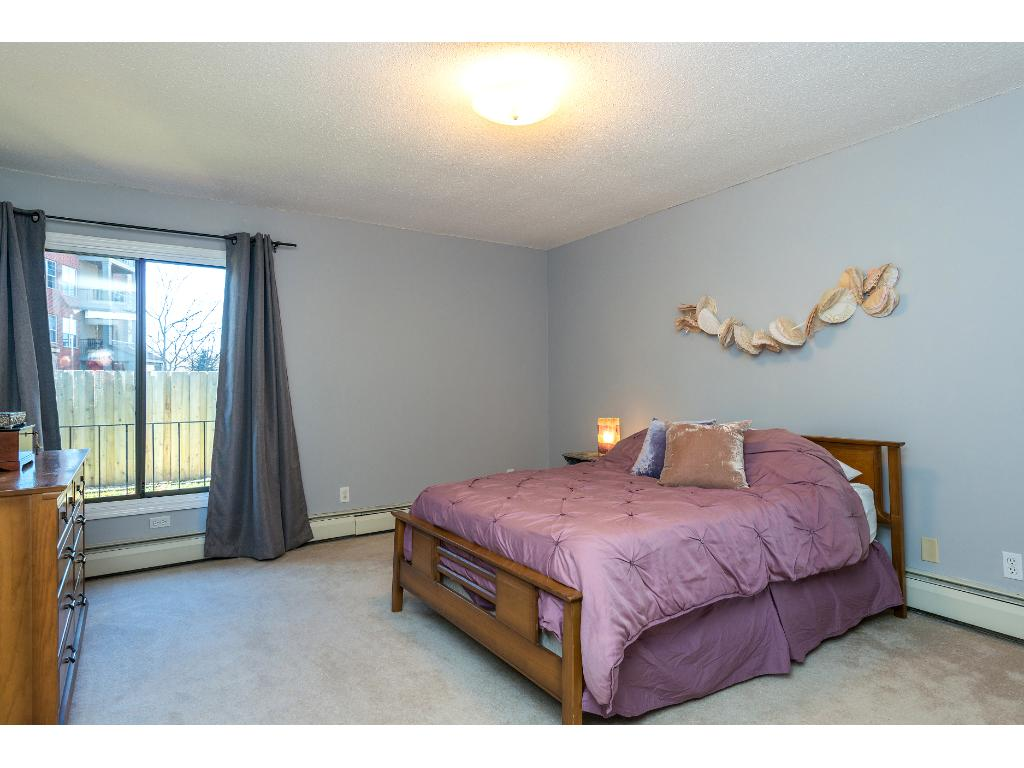 Large master bedroom easily fits whatever sized bed you have along with larger furniture pieces.
