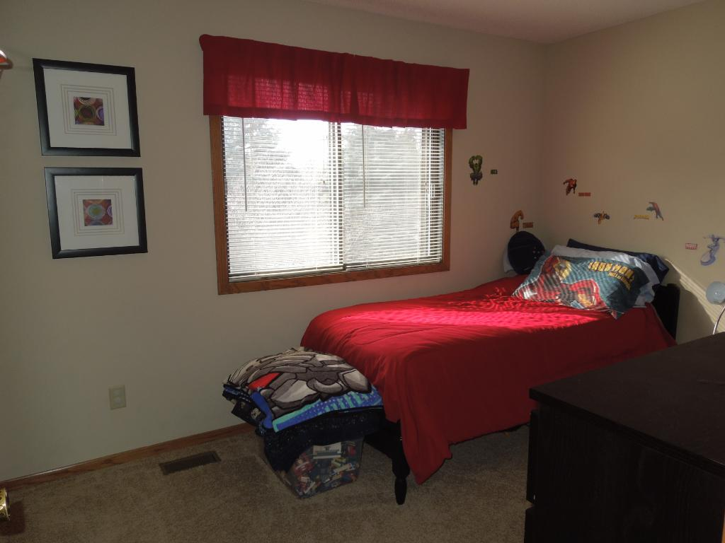 Another picture of the living room offering nice windows looking out to the private backyard & vaulted ceiling!