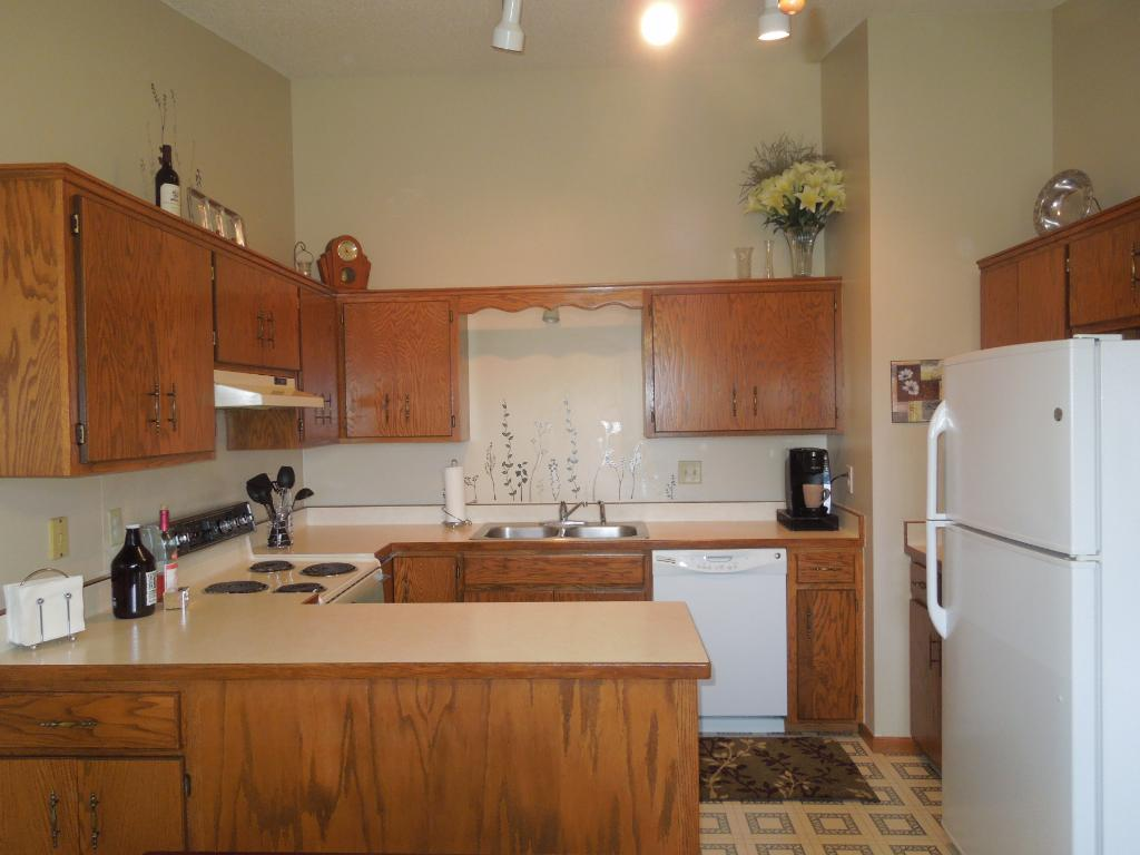 Nice size kitchen offers lots of cabinets and countertop space.  You'll also like the vaulted ceiling!