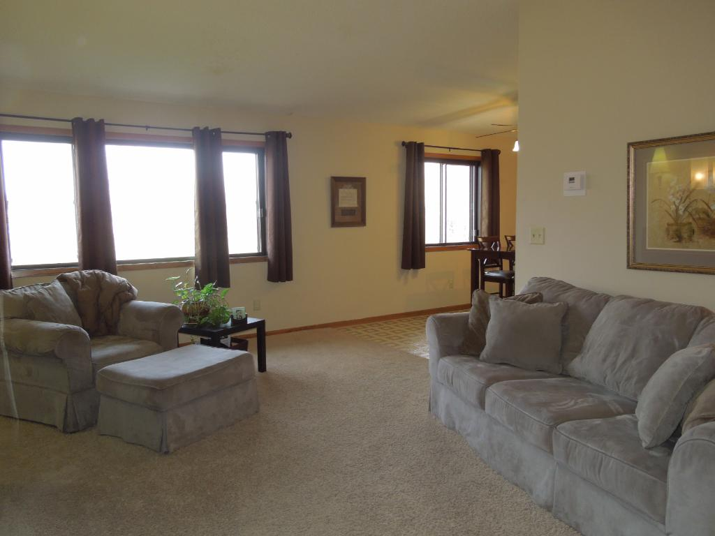 Nice size living room offering vaulted ceiling and nice windows looking out to the private backyard!