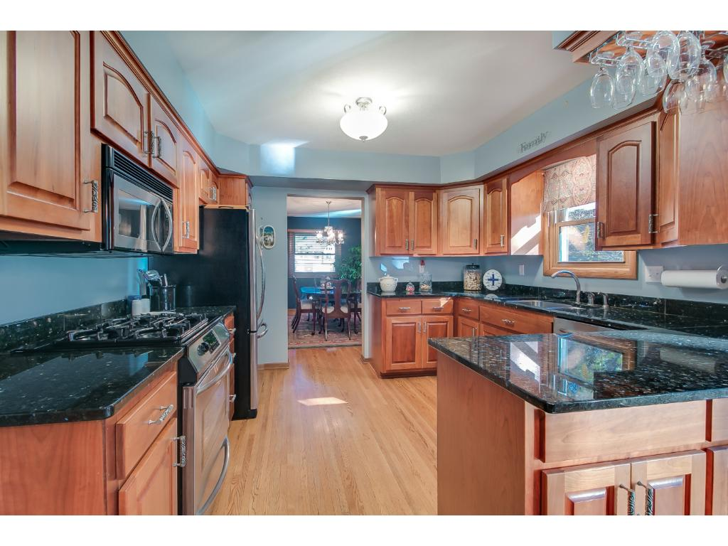 Updated kitchen with granite counter tops and stainless steal appliances.