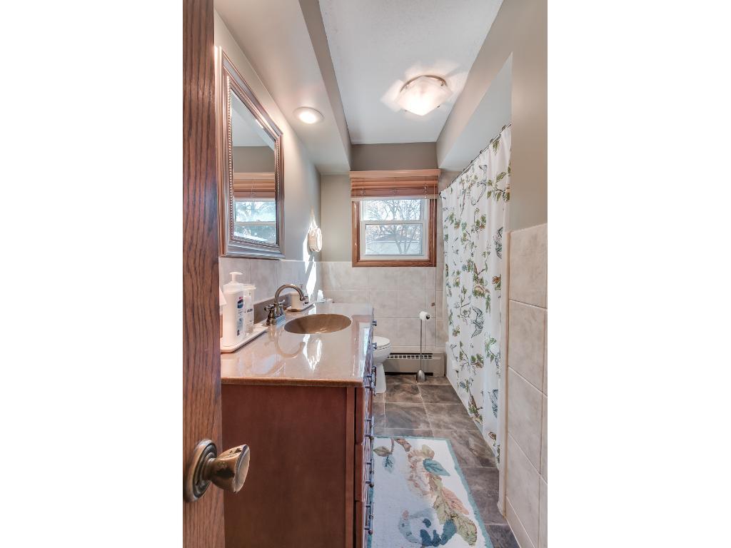 Updated full bathroom on the upper level.
