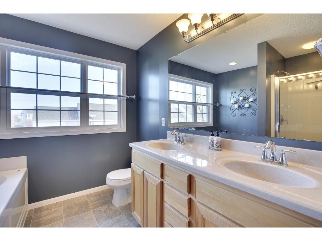 Master suite full bathroom with raised double sink vanity.