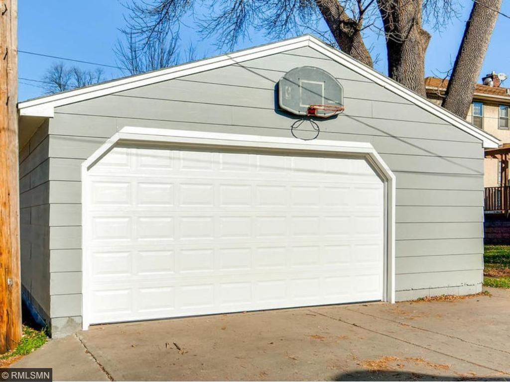 Two car garage with new overhead door and additional storage space.  Extra tall interior and concrete drive too!  PERFECT!4504 Stevens.  Park it. Here.